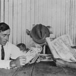 men_reading_newspaper